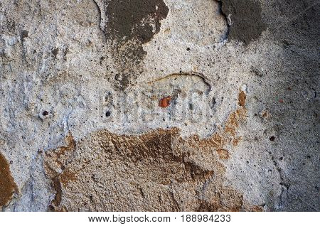 Old weathered damaged wall texture.