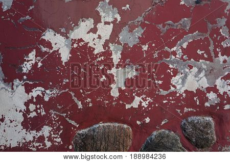 Ancient weathered damaged red wall texture.