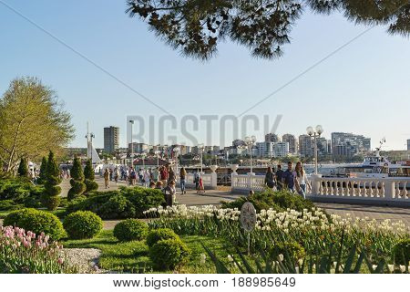 Gelendzhik Krasnodar Krai Russia - April 29.2017: Vacationers walk through the beautiful Central promenade of Gelendzhik. A warm spring day