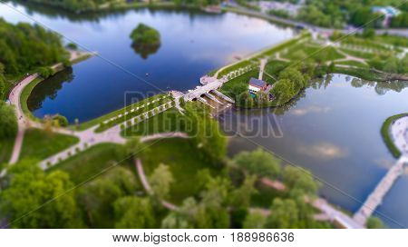 Aerial view of Tsritsyno lake with a dam - Moscow city in Russia. Park. Tilt-shift effect applied.