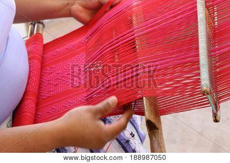 Weave - a woman is weaving in Oaxaca Mexico