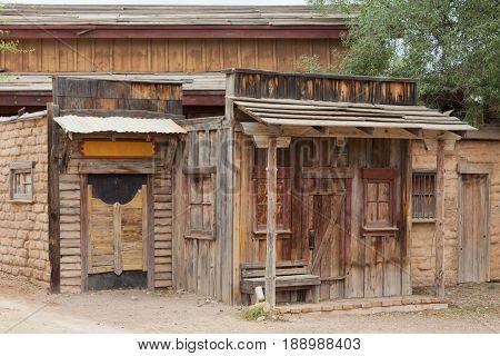 Historic saloon boarded up front door mud brick shack facade of vintage building near Tucson Arizona AZ USA