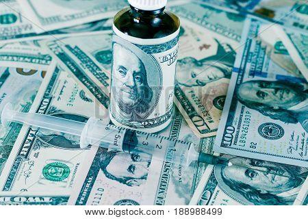 Bottle Of Drug Or Vitamin With Dollars.