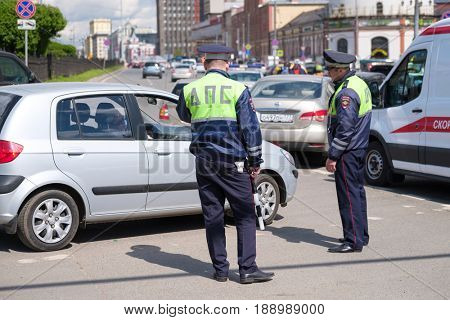 Moscow, Russia - May 28, 2017: Traffic policemen work on the street at day time