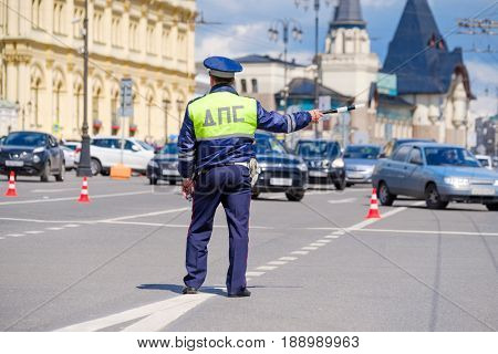 Moscow, Russia - May 28, 2017: Traffic policeman works on the street at day time