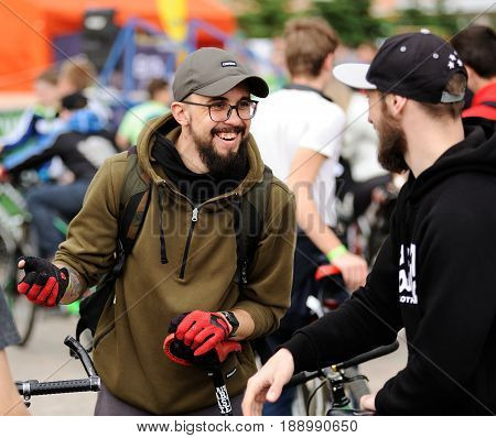 Orel Russia - May 28 2017: Bikeday. Bearded bicyclists in caps talking and smiling