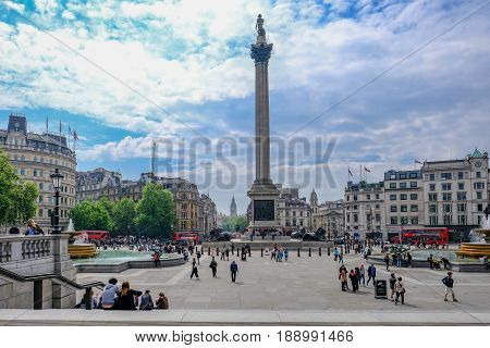 London UK - May 11 2017: Trafalgar Square taken from the steps in front of the Portrait Gallery. Shows Nelson's Column and big ben in the distance.