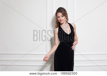 beautiful girl in black evening dress cocktail party 1
