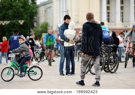 Orel Russia - May 28 2017: Bikeday. Man and woman hugging in crowd of bicyclists on square