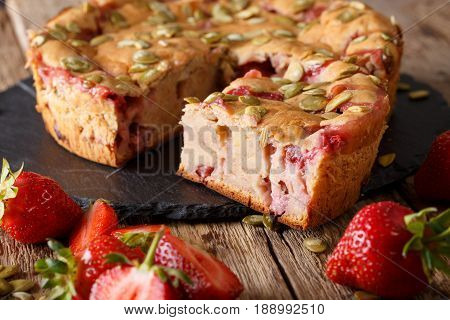 Fruit Banana Bread With Strawberries And Pumpkin Seeds Close-up On A Table. Horizontal