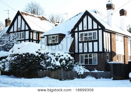 House covered in snow in winter