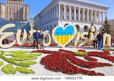 KYIV, UKRAINE - MAY 1, 2017: Unidentified tourists near part of official logo of Eurovision Song Contest 2017 on Maidan Nezalezhnosti (Independence Square)