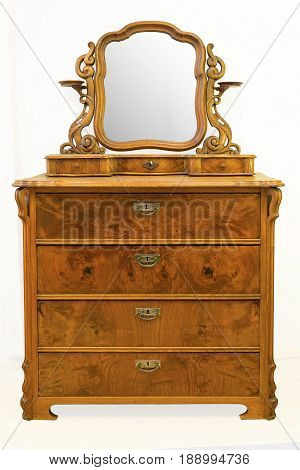 Old vintage antique chest of drawers, with a mirror on a white background