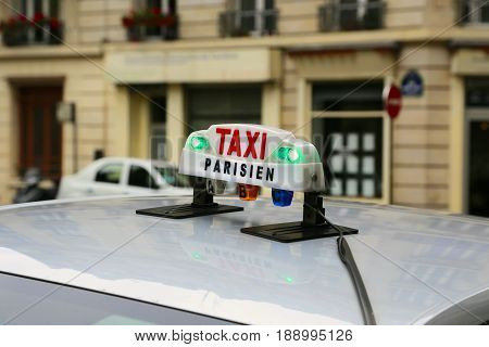 Close up of  taxicab sign in Paris, France