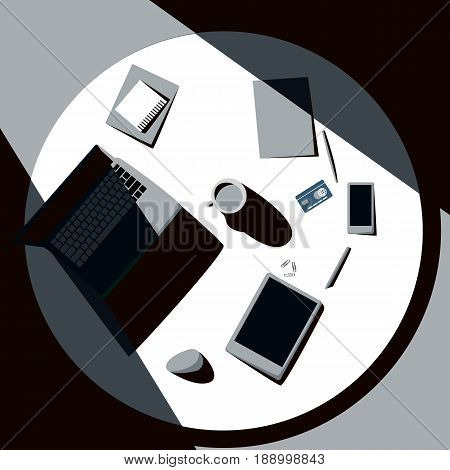 Top view of office table with laptop, tablet, cup of coffee, smartphone and credit card. Sunlight falls on a desk