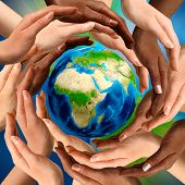 Beautiful conceptual symbol of the Earth globe with multiracial human hands around it. Unity and world peace concept. poster