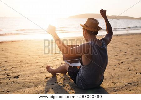 Young Male Businessman Putting Hands Up For Success On Tropical Summer Beach - It Indicates Freedom