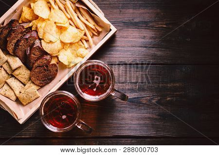 Lager Beer And Snacks. Bar Table. Restaurant, Pub, Food Concept. Delicious Drink And Salty Crispy Fo