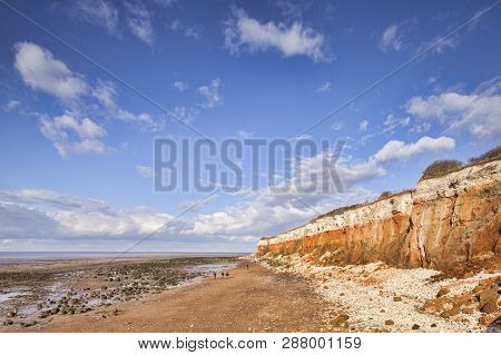 Hunstanton Cliffs In Norfolk, Where White Chalk Overlays Red Limestone In A Colourful Formation. Kno