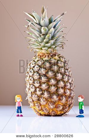Girl And Boy Overwhelmed By Nutrition Choices (pineapple)