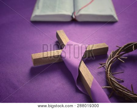 Good Friday, Lent Season And Holy Week Concept - A Religious Cross, A Bible And A Woven Crown Of Tho