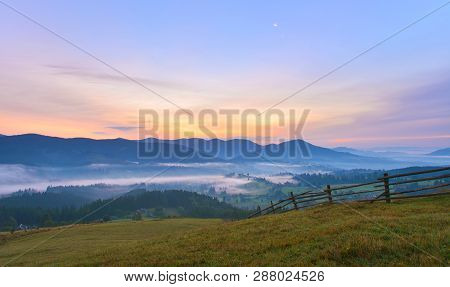 Dawn Misty Countryside. Mountains With Morning Mist At Dawn