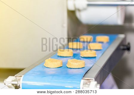 Close Up Biscuit Food On Automatic Conveyor Machine In Production Line For High Technology Industria