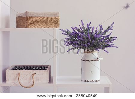 Bunch Of Fresh Lavender In Basket. White Wall On Background