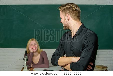 Bright Student. High School Student Saying Lesson. Male Student With Examiner At Examination. Handso