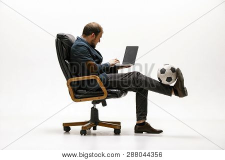 Businessman With Football Ball In Office. Soccer Freestyle. Concept Of Balance And Agility In Busine