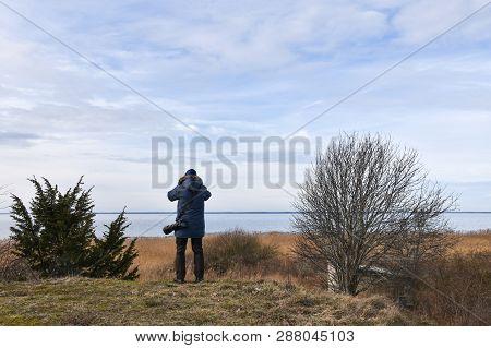 Photographer In A Coastal Landscape At The Swedish Island Oland