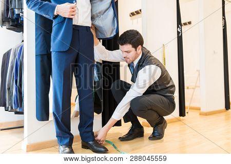 Confident Fashion Designer At Work