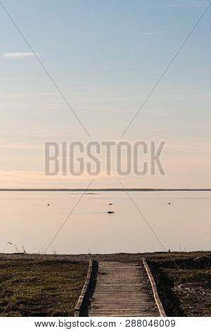 Wooden Footbridge By The Coast With Absolutely Calm Water At The Swedish Island Oland
