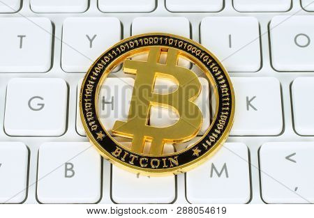 Bitcoin Cryptocurrency Coin On White Keyboard Background Close-up