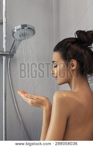 Beautiful Girl Standing At The Shower. Portrait Of Happy Mixed Race Caucasian Asian Slim Woman Takin