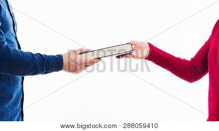 Close Up Portrait Of Man And Women Students Exchanging Books Isolated On White. Literature Sharing B
