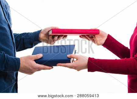 Close Up Portrait Of Man And Women Students Exchanging Different Books Isolated On White. Literature