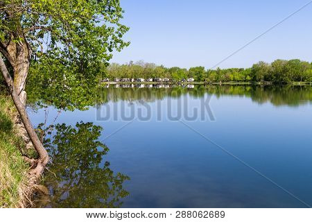 Sycamore, Illinois - May 16: Recreational Vehicles Parked At The Waters Edge With A Peaceful Reflect
