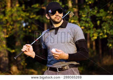 Portrait Of Golfer Or Golf Player With Golf Stick And Golf Ball In Hand In Nature On Golf Course.