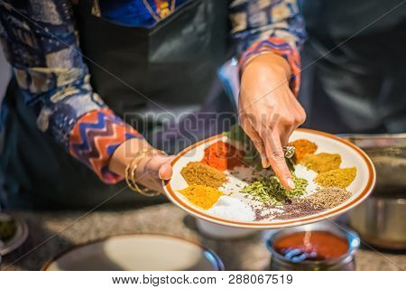 A Chef In A Cooking Class Is Demonstrating Garam Masala Made From Traditional Indian Spices And Herb