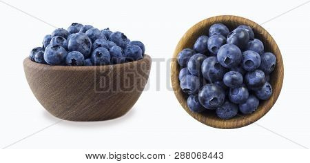 Blueberries In A Wooden Bowl. Ripe Blueberries With Copy Space For Text. Blueberry Isolated On White