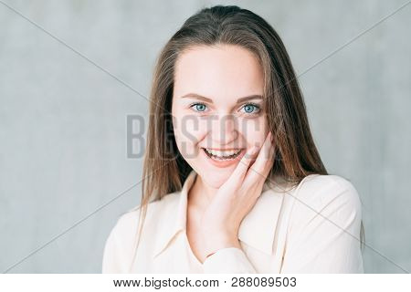 Excited Young Woman Portrait. Youth And Beauty. Skin Care. Attractive Female Touching Face.