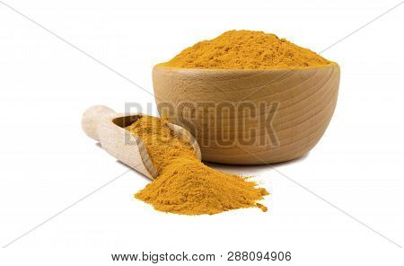 Turmeric Powder In Wooden Bowl And Scoop Isolated On White Background. Spices And Food Ingredients.