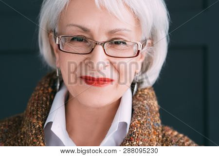 Senior Female Portrait. Modern Elderly Lady Lifestyle. Smiling Successful Aged Woman Looking At Came