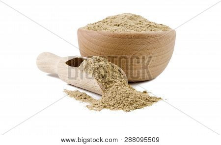 Cardamon Powder In Wooden Bowl And Scoop Isolated On White Background. Spices And Food Ingredients.