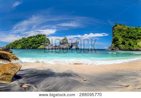 View of idyllic tropical beach with small island and perfect azure clean water - nobody / Indonesia, Bali, Nusa Penida