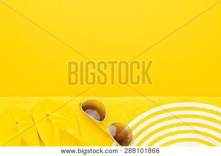 Beach Accessories On The Yellow Background - Sunglasses, Towel. Flip-flops And Striped Hat. Summer I