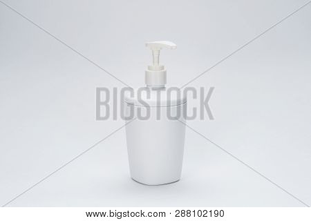 White Soap Dispenser On The Grey Background