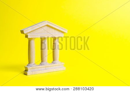 Wooden Government Building On A Yellow Background. The Authorities, The Sovereignty Of The Country A