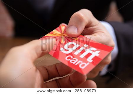 Two Hands Holding Gift Card